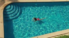 Woman Swimming In Pool stock footage