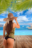 Woman by the swimming pool at tropical resort Stock Photo