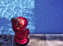 Woman at the swimming pool royalty free stock images