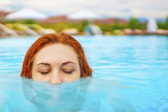Woman swimming in the pool. royalty free stock photography