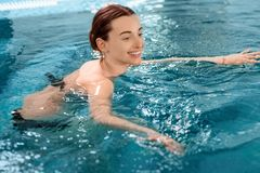 Woman in the swimming pool Royalty Free Stock Photo