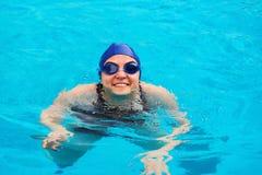 Woman swimming in pool stock photo