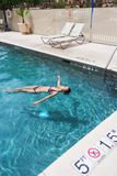 Woman in swimming pool Stock Photography