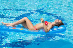 Woman swimming and relaxes in the pool Stock Photo