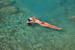 A woman is swimming in a sea Stock Photography