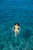 Woman swimming in the sea Stock Photography