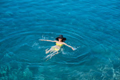 Woman swimming in the sea Royalty Free Stock Images