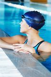 Woman in swimming suit near pool Stock Photography