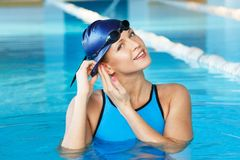 Woman in swimming suit near pool Stock Images
