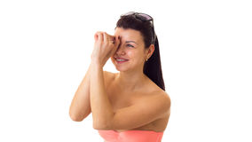 Woman in swimming suit with sunglasses. Smiling young woman with long ponytail in pink bra and denim shorts with black sunglasses on white background in studio Royalty Free Stock Photography
