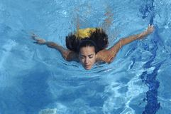Woman swimming a summer day Stock Photos