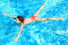Woman is swimming in swimming pool Royalty Free Stock Photos