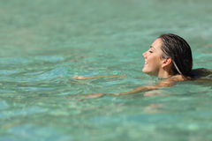 Woman swimming in a tropical sea on holidays Stock Photo
