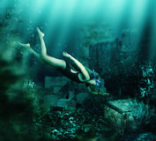 Woman swimming underwater. Adventure Royalty Free Stock Photography
