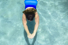 Woman Swimming Underwater Royalty Free Stock Images