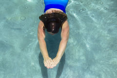 Woman Swimming Underwater Stock Photography