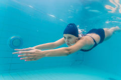 Woman swimming underwater in pool Royalty Free Stock Photo