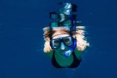 Woman swimming underwater Royalty Free Stock Image