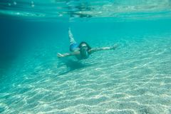 Woman swimming underwater Stock Images