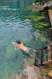 Woman swimming in very Clean and Clear lagoon lake Royalty Free Stock Photo