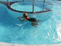 Woman swimming in the vortex pool Royalty Free Stock Images