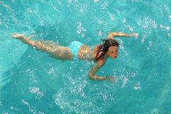 Woman swimming in water. Young woman swimming in water pool Royalty Free Stock Photo