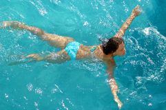 Woman swimming in water pool Royalty Free Stock Photos