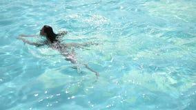 Woman swimming stock footage