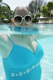 Woman in swimmingpPool. A woman in a swimming pool half under water Stock Photography