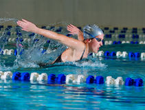 Woman swims using the butterfly stroke