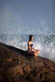 Woman in swimsui meditates Stock Images