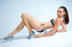 Woman in swimsuit. Woman in silver swimsuit and high heel shoes Royalty Free Stock Image