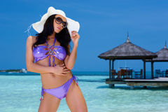 Woman in Swimsuit. Beautiful and sexy woman in swimsuit at Maldives Stock Photo