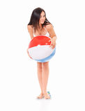 Woman in swimsuit with ball Stock Images