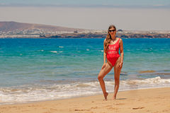 Woman in swimsuit on beach Royalty Free Stock Photo