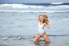 Woman in the swimsuit on the beach Royalty Free Stock Photo