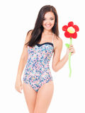 Woman in swimsuit with big flower stock photos