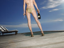 Woman In Swimsuit With Champagne By Pool Stock Photography