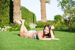 Woman in a swimsuit on the grass Royalty Free Stock Photo