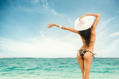 Woman in swimsuit and hat at sea. Rear view Stock Images