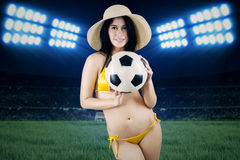 Woman in swimsuit holding ball at field 2 Stock Photo