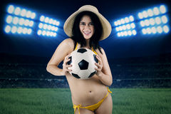 Woman in swimsuit holding ball at field 3. Portrait of sexy woman wearing bikini holding a soccer ball at field Royalty Free Stock Photos