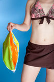 Woman in swimsuit holding deflated beach ball Stock Photography