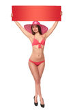 Woman in swimsuit holding red blank cardboard Stock Images