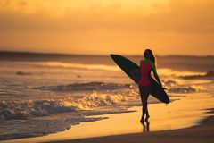 Woman in swimsuit holding a surfboard stock images