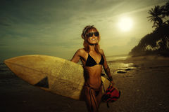 Woman in swimsuit holding a surfboard stock image