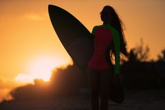 Woman in swimsuit holding a surfboard royalty free stock photos