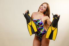 Woman in swimsuit holds flippers having fun Royalty Free Stock Photo
