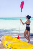Woman in swimsuit with paddle Royalty Free Stock Photography