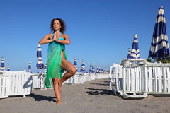 Woman in swimsuit and pareo stands on beach Stock Images